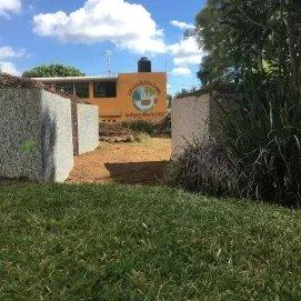 Projet de trois buttes encadrées dans une école d'enfants trisomiques